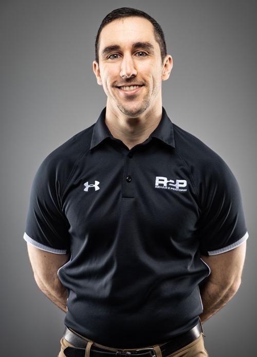 Dr. Anthony Iannarino headshot on a grey background
