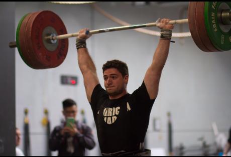 Man lifting with barebell overhead