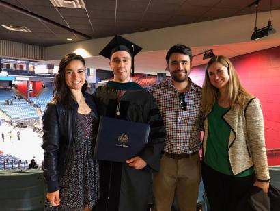 Man with DPT degree celebrating with family