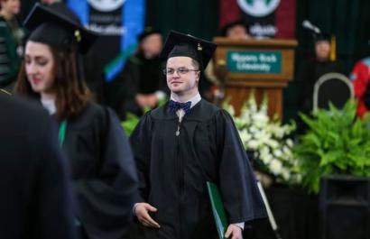 man holding college undergraduate degree