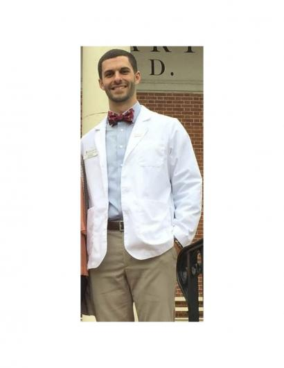 Man with white coat from PT school