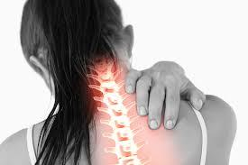 Woman grabbing neck showing spine pain