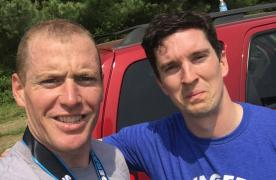 2 men after savage race with an r2p shirt